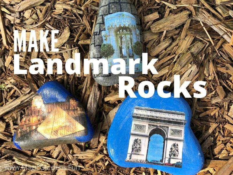 Three rocks with Paris landmarks DIY attached the louvre Laurdrer restaurant and the Arc De Triomphe and the words Make Landmark Rocks over mulch